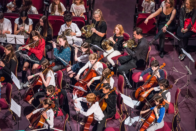 Part of our orchestra, playing trumpet, French horn, cello, clarinet and flute.