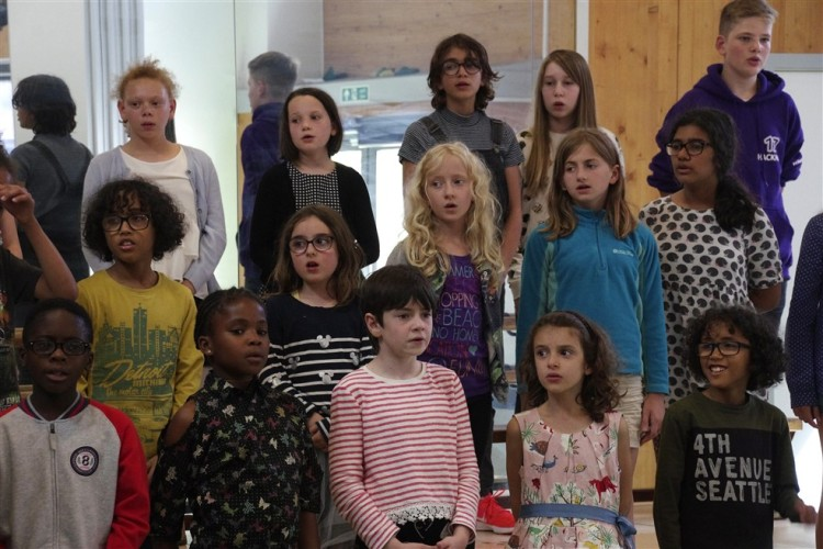 A group of HYOT students aged around 8 to 12 years, in the choir at one of our summer music schools.