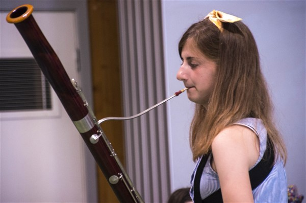 A young person playing a solo on bassoon.